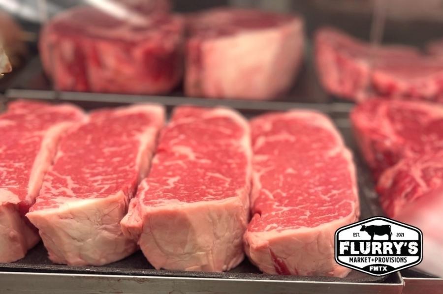 New York strip steaks on display