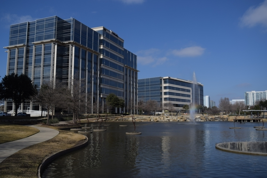 Hall Park building in Frisco and pond