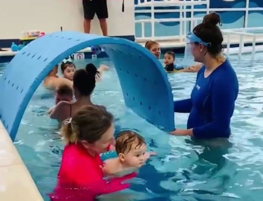 Women and kids in pool