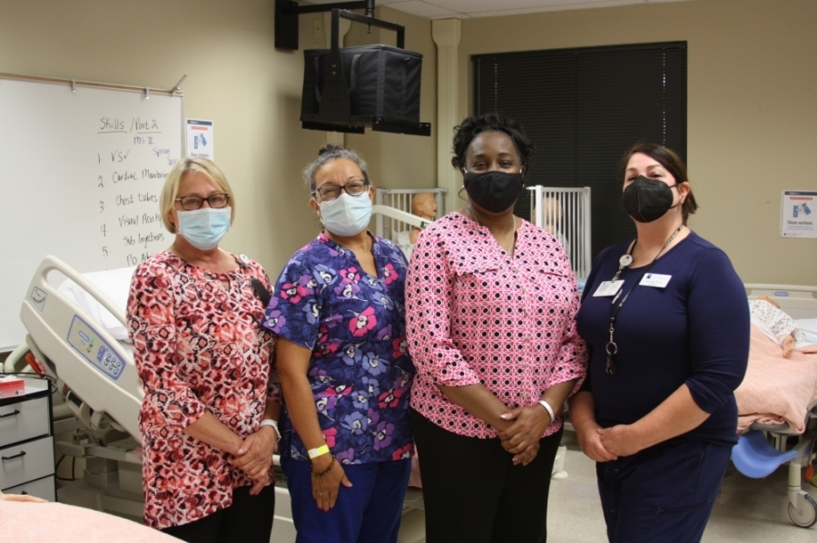 From left, Janice Roth, Ivette Sterling, Dr. Rhonda Webb and Annette Bailey coordinate the vocational nursing program in New Braunfels. (Lauren Canterberry/Community Impact Newspaper)