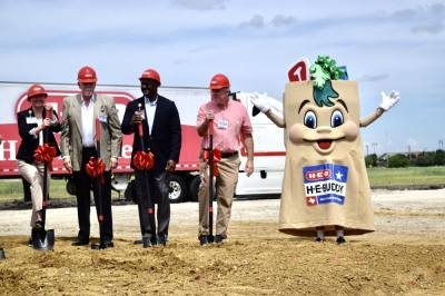 H-E-Buddy, the mascot for H-E-B, poses after public officials and grocery chain executives broke ground at the site for the first H-E-B in Frisco. (Matt Payne/Community Impact Newspaper)
