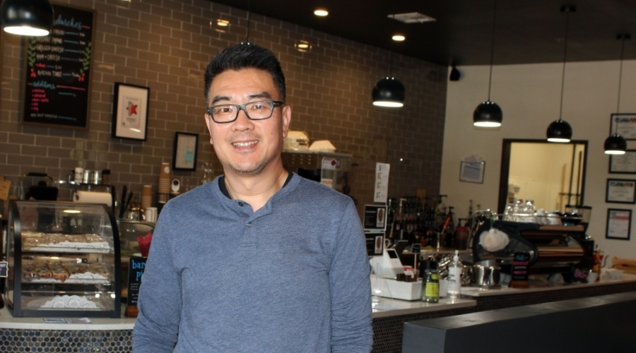 co-owner Wenxin Wang stands in front of the counter at Beanvoy Coffee Lounge