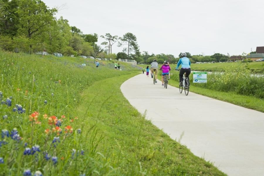 Residents bike along the Brays Bayou Greenway Trail in Houston. (Courtesy Houston Parks Board)