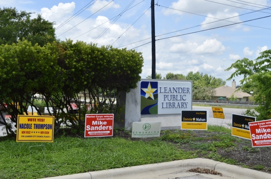 Signs outside Leander Public Library