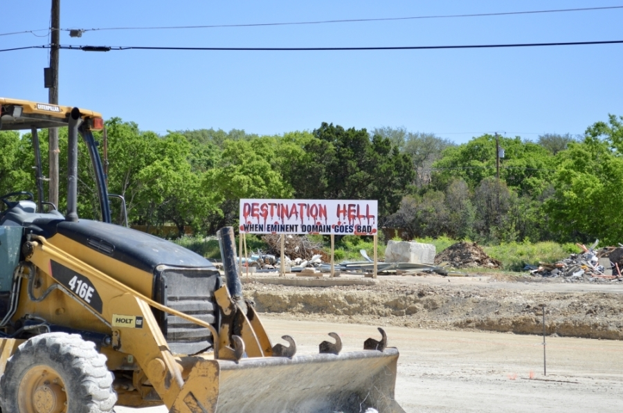Landowner Tina Mallach built this sign as she seeks more money from Cedar Park for land condemned as part of the Bell Boulevard realignment project. (Taylor Girtman/Community Impact Newspaper)
