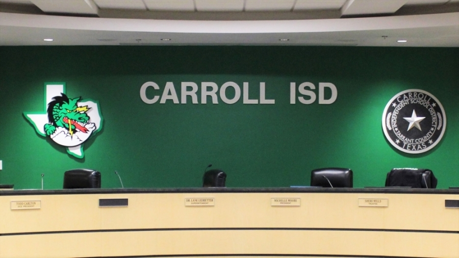 an empty dais for the Carroll ISD board of trustees