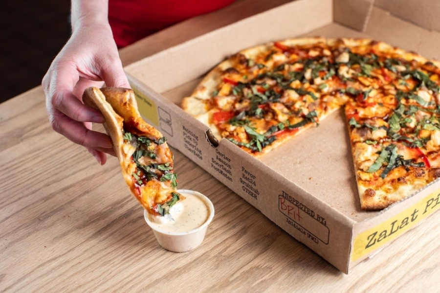 pizza dipping in ranch