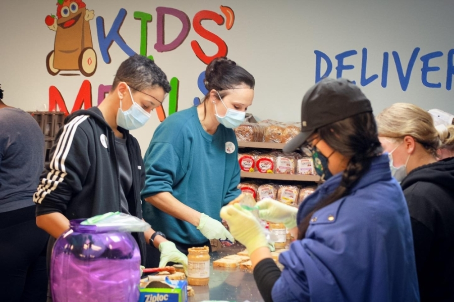 Volunteers at Kids Meals Inc. in the Garden Oaks area help put together meals and grocery bags for families in need. (Courtesy Kids Meals Inc.)