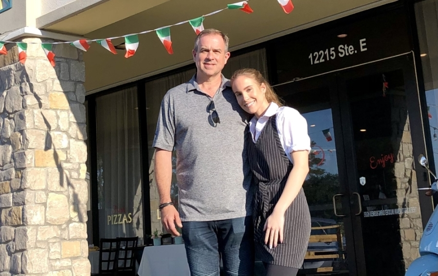 Dejan Medanic owns Tuscany Italian Bistro on Grant Road, where his daughter Claudia works as a server. (Andy Yanez/Community Impact Newspaper)