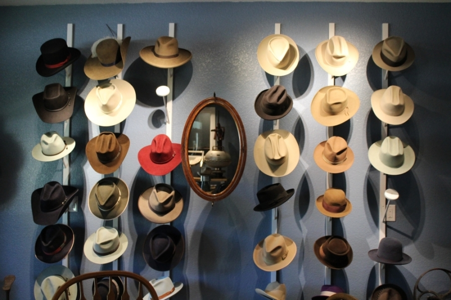 Walking inside the shop, a variety of hats are perched along the wall ranging from film noir fedoras to cowboys hats. (Megan Cardona/Community Impact Newspaper)