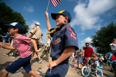 Boy Scout with flag in parade