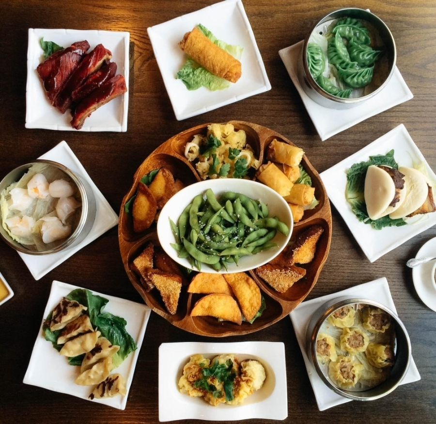 aerial image of several plates with dishes offered by Howard Wang's China Grill