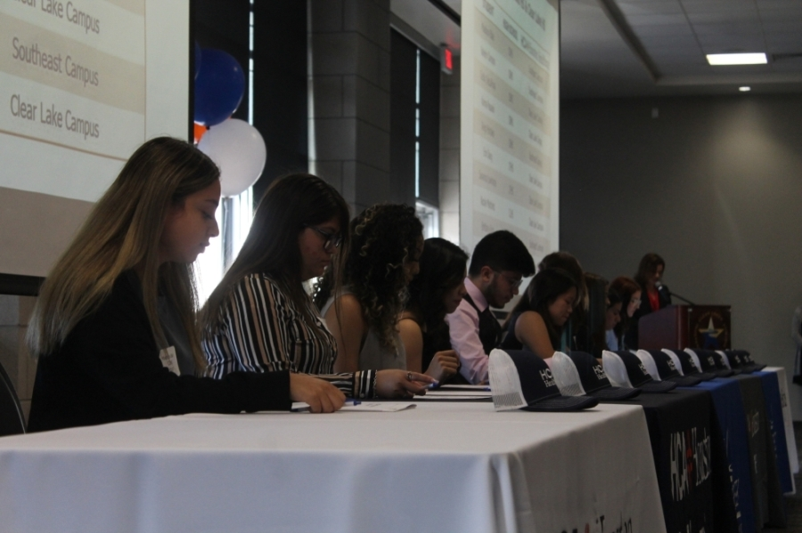 A total of 37 graduating seniors from CCISD make up the inaugural class for the new partnership with HCA Houston Healthcare; they signed their official offer letters during a June 9 ceremony. (Colleen Ferguson/Community Impact Newspaper)