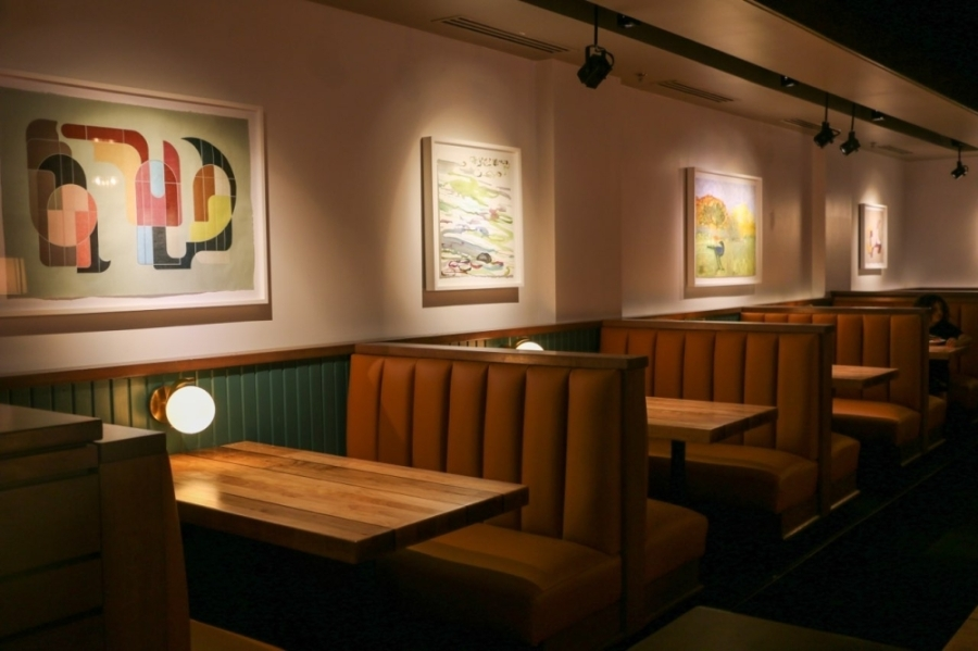 Booths and art prints in Towne Grill's dining room