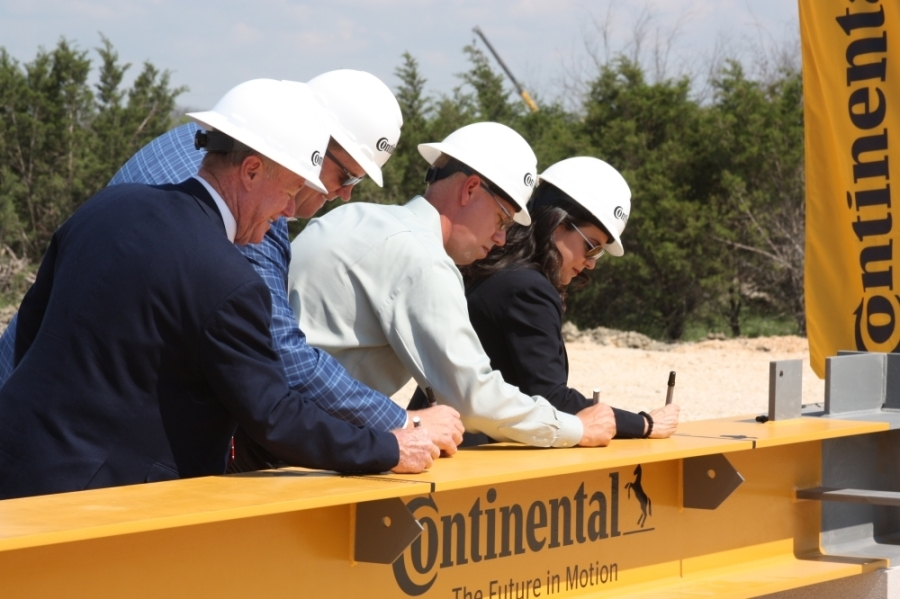 Representatives from Continental and the City of New Braunfels signed a beam that will be used in the construction of the facility. (Lauren Canterberry/Community Impact Newspaper)