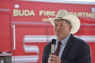Hays County Precinct 2 Commissioner Mark Jones speaks during the FM 2001 groundbreaking event. (Warren Brown/Community Impact Newspaper)