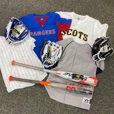 baseball jerseys, two baseball bats and three baseball gloves