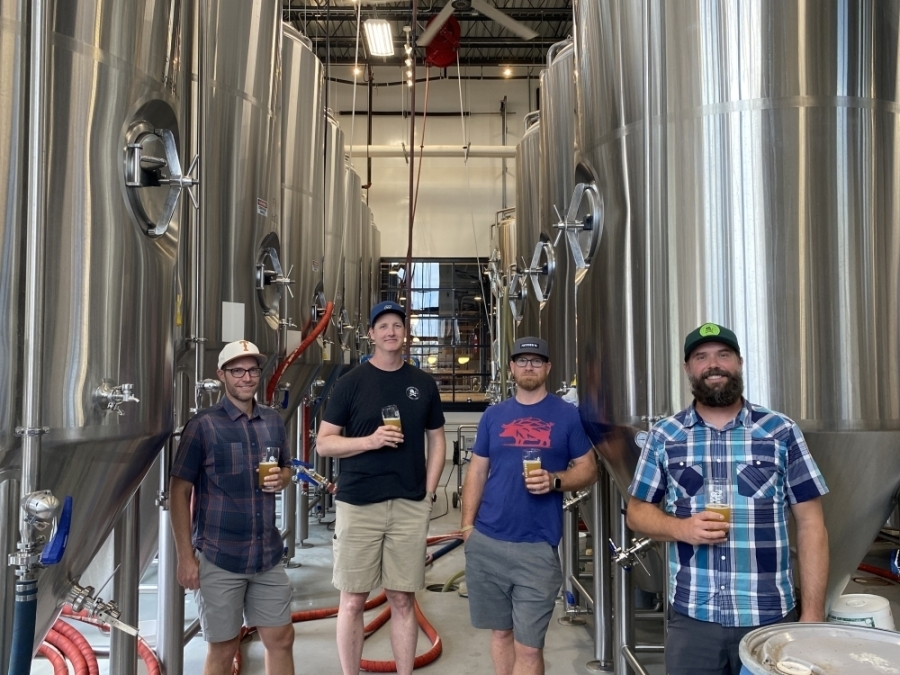 From left to right stand co-founders Tyler Norwood, Ned Lavelle, Kyle Detrick and Joe Mohrfeld inside the brewery of the Round Rock location. Not pictured are co-founders Ryan Van Biene and Nic Van Biene.