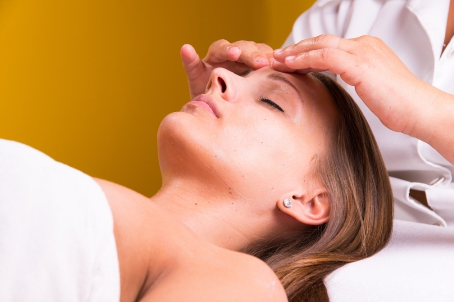 A woman having her forehead massaged