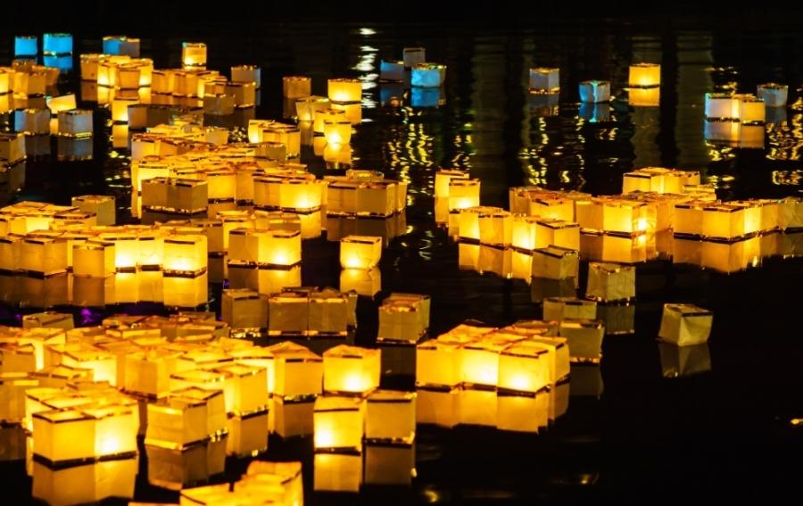 water lanterns float on a lake