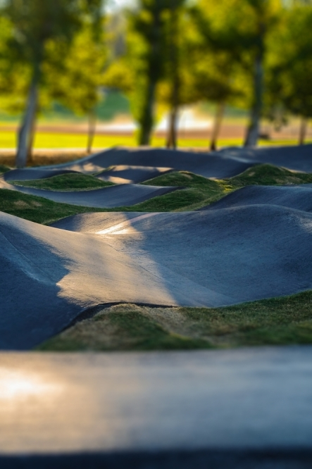 The proposed pump track would be a connected system of rollers and banked turns for cyclists to ride with minimal pedaling, located next to the park's parking lot.  (courtesy Pexels)