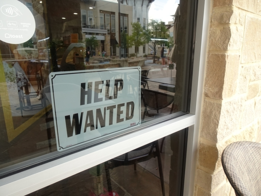A 'help wanted' sign is posted in the window of Coco Crepes in Cypress. (Emily Jaroszewski/Community Impact Newspaper)