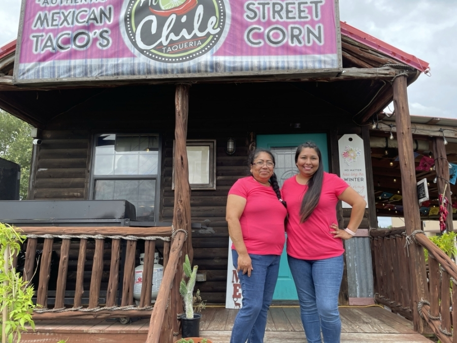 Sandy (left) is passing along the family recipes to her 17-year-old daughter Jessica, who works the taco stand along with other family members. (Carrie Taylor/Community Impact Newspaper)