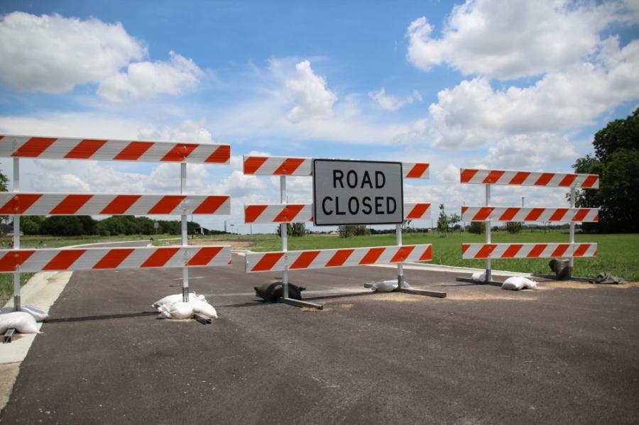Temporary barricades currently in place on Main Street. (Megan Cardona/Community Impact Newspaper)
