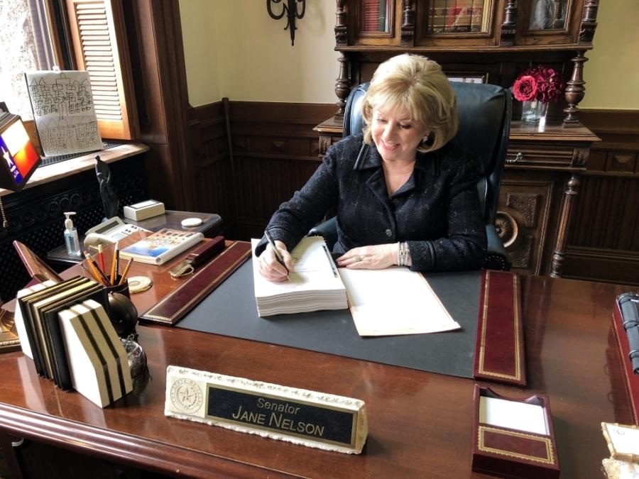 woman writing on desk
