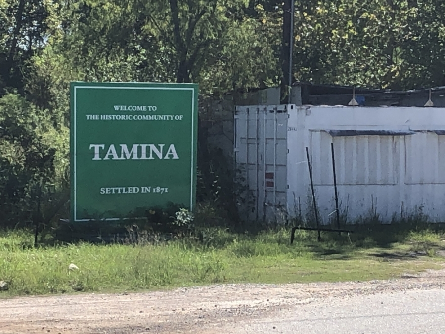 A sign marks the boundaries of the unincorporated Tamina community. (Andrew Christman/Community Impact Newspaper)