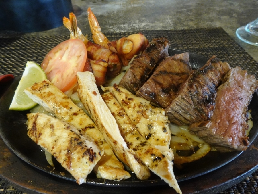 Fajitas come with an assortment of meats to choose from, such as shrimp, chicken, or beef with grilled onions. All fajitas are served with a side of rice and refried beans ($17-$46). (Emily Jaroszewski/Community Impact Newspaper)