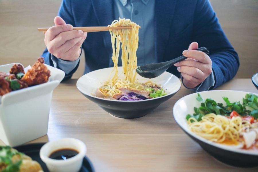 Photo of a man eating ramen