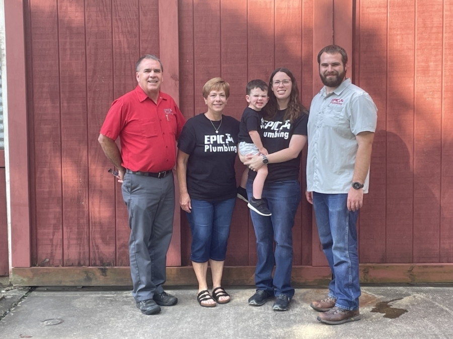 From left: Todd Iocco, Denesse Iocco, April Maly and Bryant Iocco own Epic Plumbing. In Maly's arms is her son, Thomas Maly. (Haley Morrison/Community Impact Newspaper)