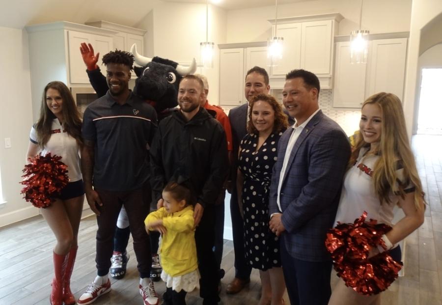 Operation Finally Home partnered with the Houston Texans to award Stephen Netzley (center) his new home. (Emily Jaroszewski/Community Impact Newspaper)