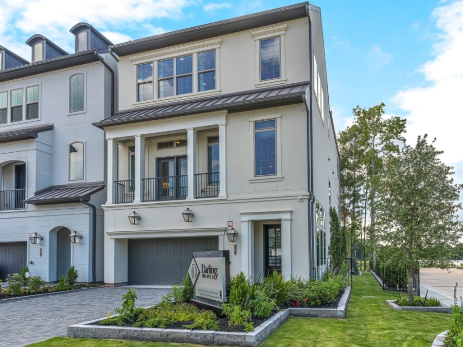 The three-story model home on Vue Cove Drive includes a front patio and a first-floor garage. Buyers can build from a range of three-story and four-story townhome models. (Photos courtesy Taylor Morrison)