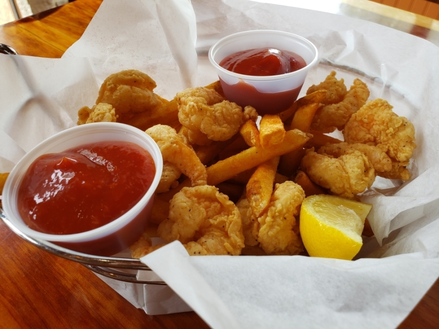 The fried shrimp basket ($10) comes with fries. (Ali Linan/Community Impact Newspaper)