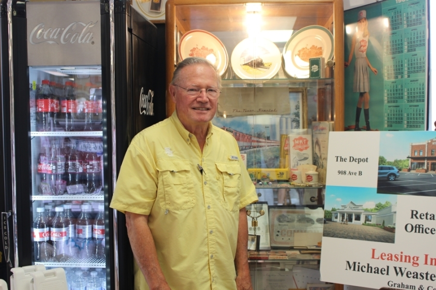 KT Antiques owner Bill Bain opened the antique store in 2010. (Morgan Jones/Community Impact Newspaper)