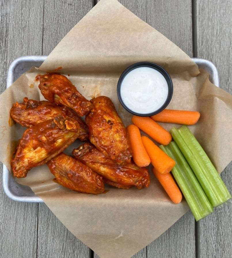 Menu items include traditional and boneless chicken wings; hand-breaded chicken tenders; chicken sandwiches; and sides such as beer-battered onion rings, potato wedges and fried pickles. (Courtesy Buffalo Wild Wings)