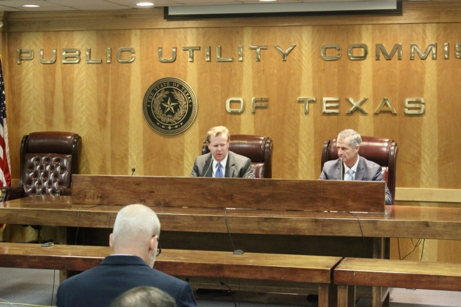 Peter Lake (left), chair of the Public Utility Commission of Texas, and Brad Jones, interim president and CEO of the Electric Reliability Council of Texas, provided an update on state regulators' electric grid redesign efforts in Austin on July 22. (Ben Thompson/Community Impact Newspaper)