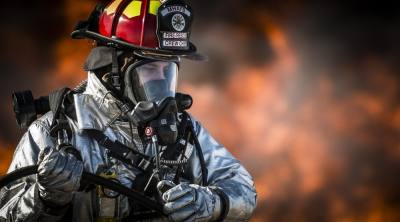 person in fire fighting suit