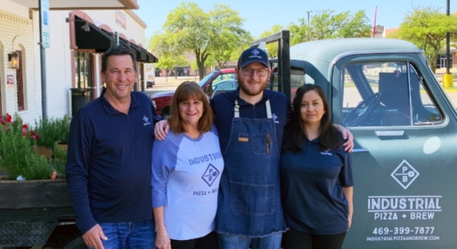 Kelly Newsom, left, and his wife, Becky, co-own the restaurant with their son, Hunter, and his wife, Mariana. (Courtesy Industrial Pizza   Brew)