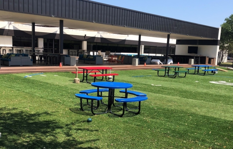 picnic tables on turf