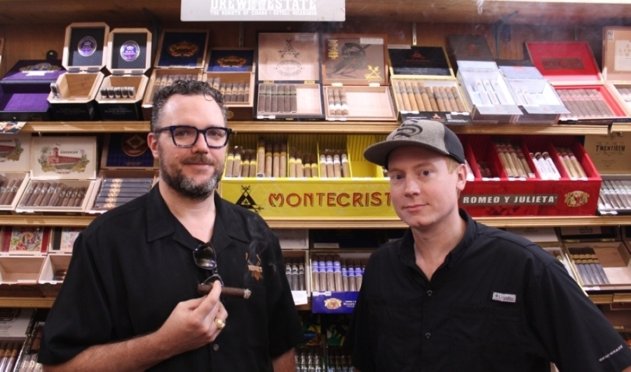 Owner Bob Peacock (left) is the son of Mike, who bought Michael's Tobacco in Euless 15 years ago. Brandon Payne (right) manages the Keller store. (Kira Lovell/Community Impact Newspaper)