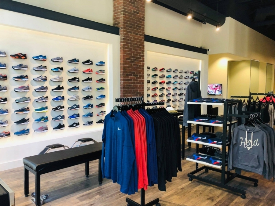 Racks of shoes and other running gear