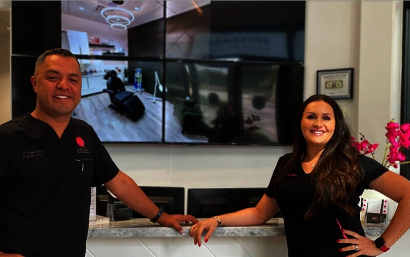 Owners Al and Brandie Heredia at Unmarked Beauty and Wellness in Chandler. (Alexa D'Angelo/Community Impact Newspaper)