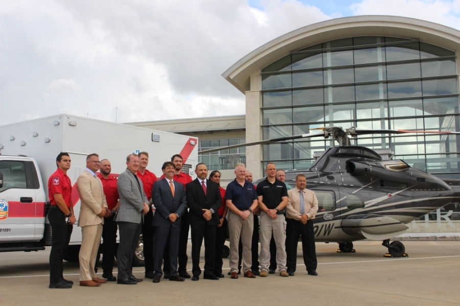 Cypress Creek EMS and American Jet International officials celebrate the beginning of their new partnership at Million Air terminal at Hobby Airport. (Wesley Gardner/Community Impact Newspaper)