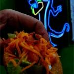 At Blue Gecko, a Texas Taco comes with seasoned ground beef, lettuce, tomato, sour cream, cheese and bacon. (Courtesy Blue Gecko)