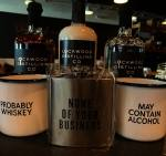 Alcohol-related merchandise, such as these flasks and cups, are sold in the new retail market at Lockwood Distilling Co. (Courtesy Lockwood Distilling Co.)