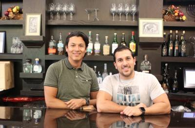 Manager David Tenorio (left) and owner Jason Goldstein (right) founded Genesis Steakhouse. (Savannah Kucher/Community Impact Newspaper)