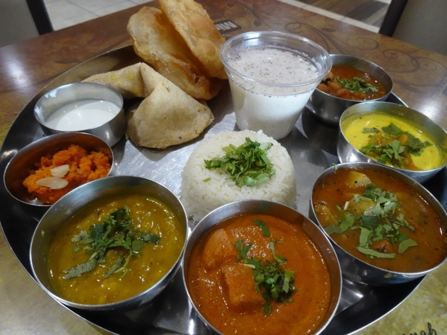 The special thali comes with five plates consisting of vegetables, rice, lentils and chutney. (Emily Jaroszewski/Community Impact Newspaper)